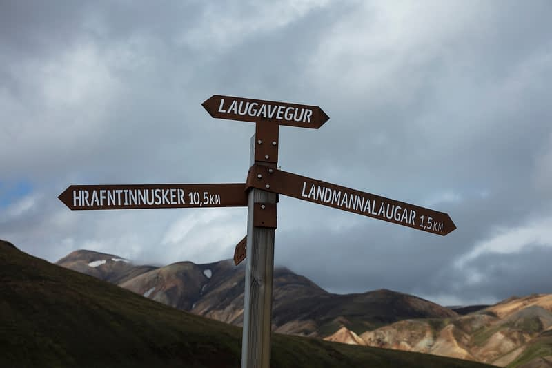 Laugavegur trail hiking signpost near Landmannalaugar. Central Highlands, Sudhurland, Iceland.