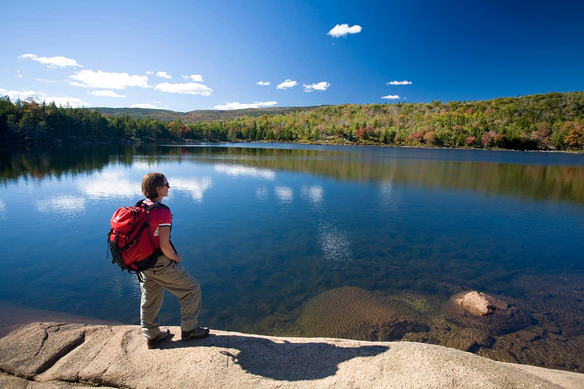 Hiker beside The Bowl, Acadia National Park, Maine, USA,