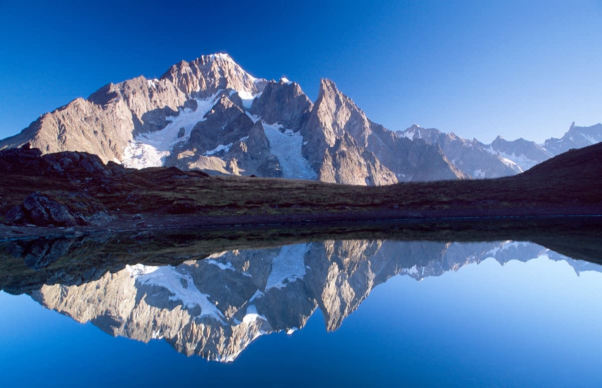 Reflection of the south face of Mont Blanc, Val Veni, Italian Alps, Italy.