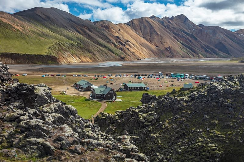 FI hut and campground beneath rhyolite mountains at Landmannalaugar. Laugavegur trail, Central Highlands, Sudhurland, Iceland.