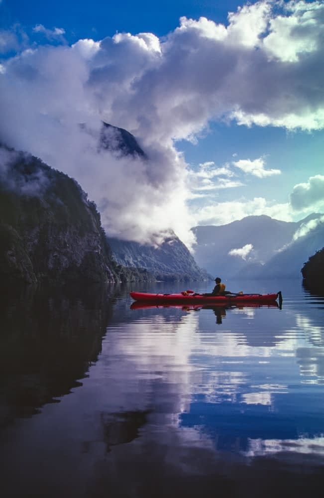 Sea kayaking in Hall Arm, Doubtful Sound, Fiordland National Park, South Island, New Zealand.