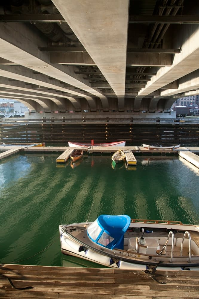 Boat moored under a bridge, Boston harbour, Massachusetts, USA.