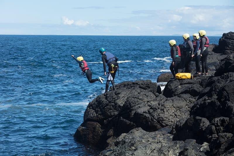 Coasteering at the Sloc, Dunseverick, Causeway Coast, Country Antrim, Northern Ireland.