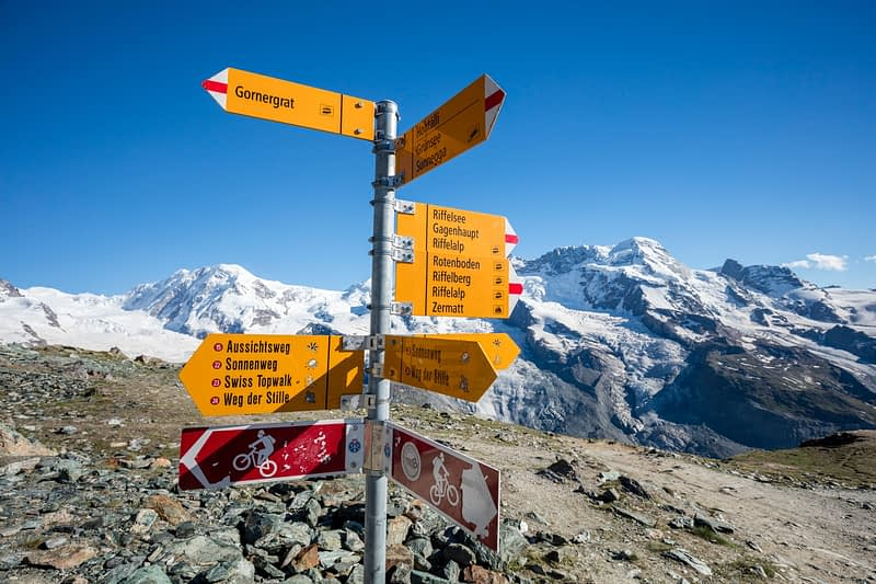 Hiking signpost beneath Monte Rosa, Gornergrat, Zermatt, Valais, Switzerland.