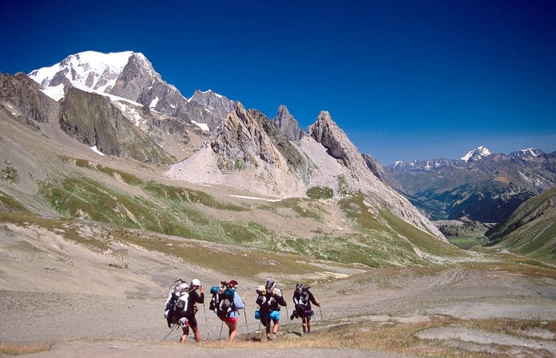 Trekkers on the Tour of Mont Blanc, Val Veni, Italian Alps, Italy.