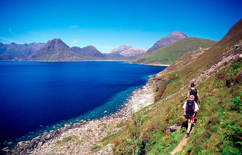 Walkers on the coast path near Elgol, Isle of Skye, Scotland.