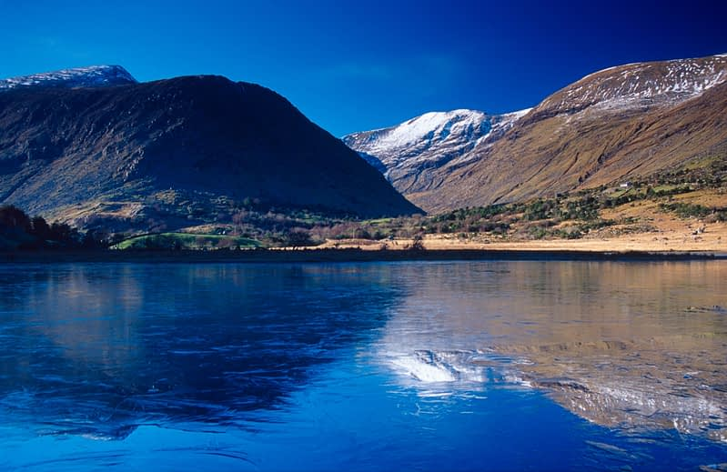 Winter reflections of the MacGillcuddy's Reeks, Cummeenduff Lough, Co Kerry, Ireland.