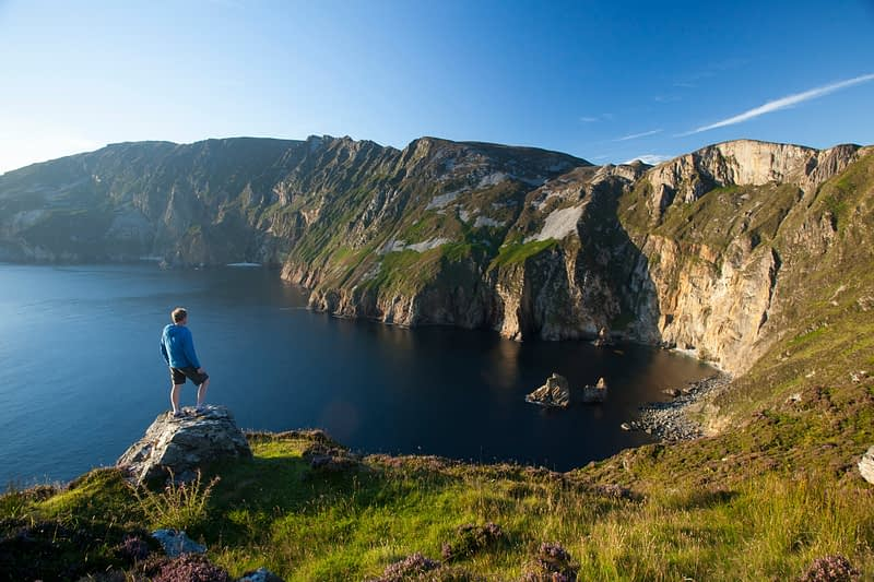 Person surveying the Slieve League cliffs from Bunglas, County Donegal, Ireland.
