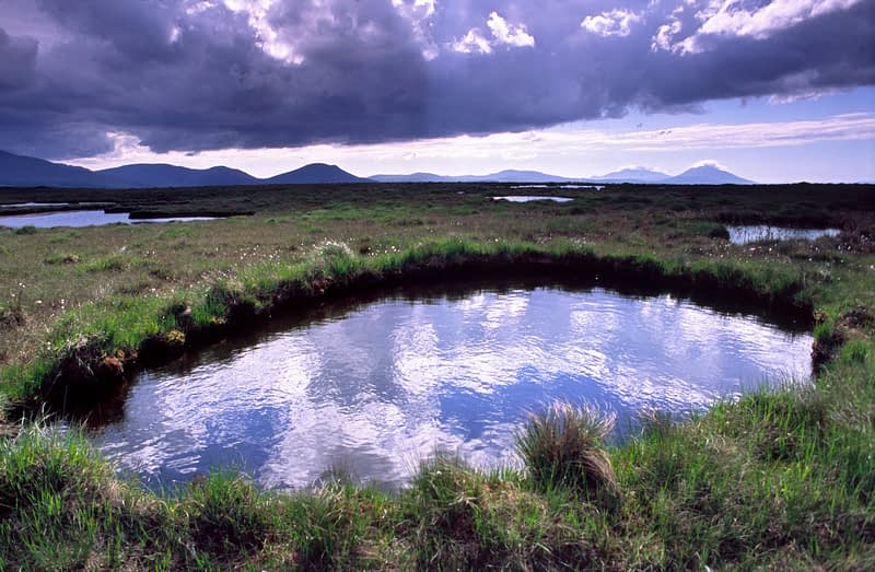 Sky reflected in a bog pool, Nephin Beg Mountains, Co Mayo, Ireland.