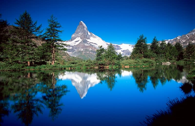 The Matterhorn reflected in the Grindijsee, Valais, Swiss Alps, Switzerland.