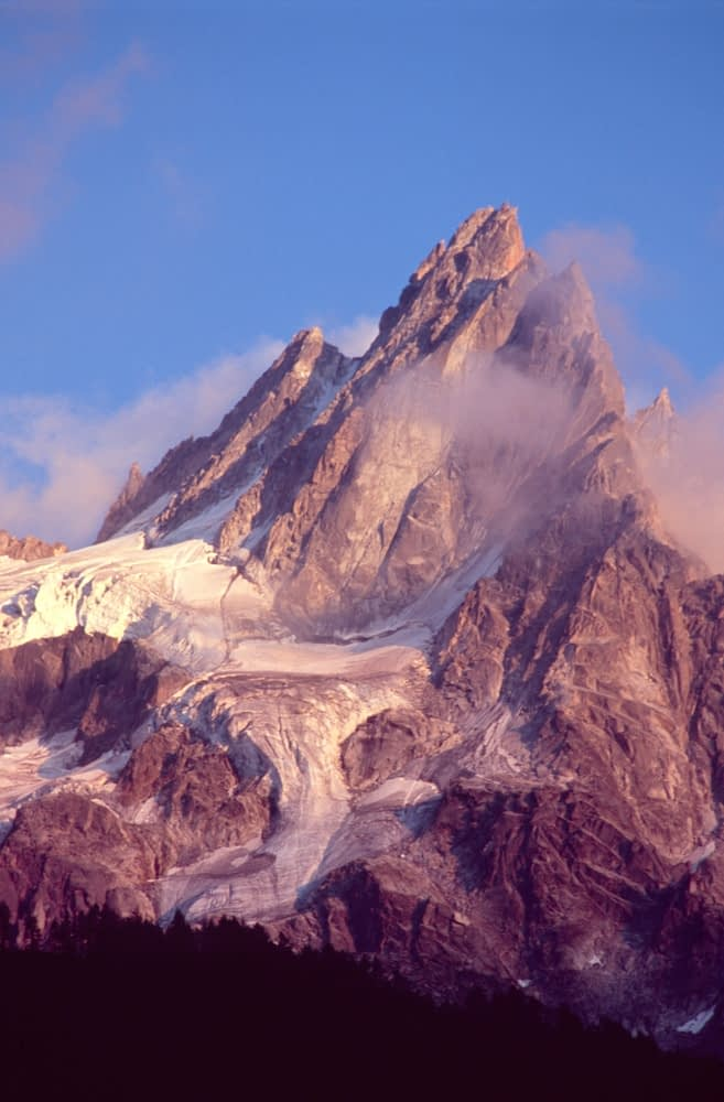 Evening cloud around the Chamonix Aiguilles, French Alps, France.