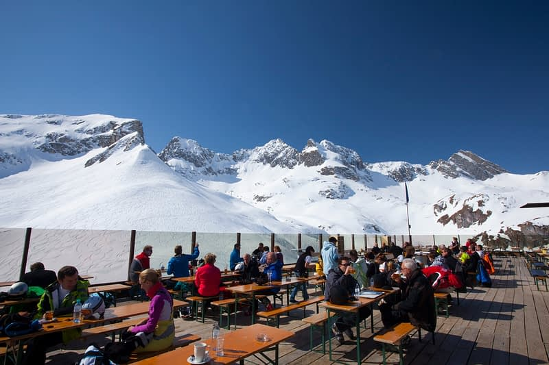 Skiers having lunch on a terrace above Zurs, Arlberg, Austria.