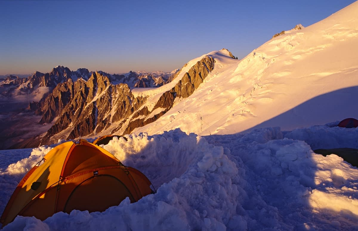 Camping on the Aigulle du Gouter during an ascent of Mt Blanc, French Alps, France.