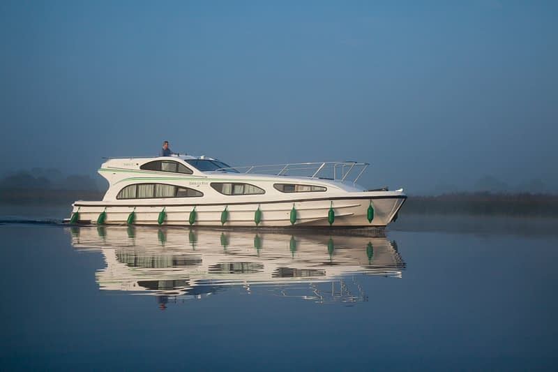 Cruiser reflection, Lough Ree, River Shannon, County Westmeath, Ireland.