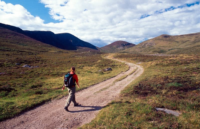 Walker on the track to Windy Gap, Eagle Mountain, Mourne Mountains, Co Down, Northern Ireland.