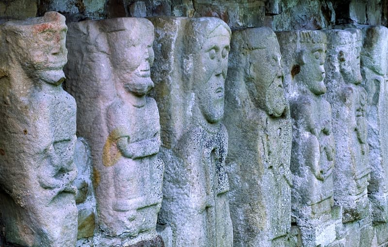 Carved figures in 12th century church, White Island, Lough Erne, Co Fermanagh, Northern Ireland.