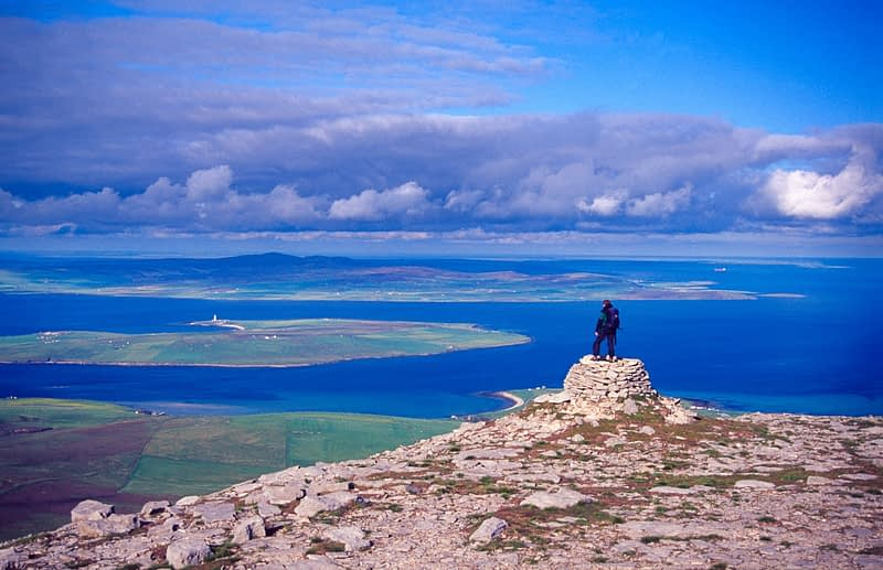 Walker on the summit of Cuilags, Hoy, Orkney Isles, Scotland.