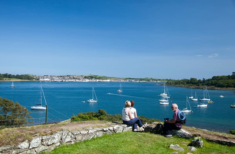 Visitors enjoying the view across Strangford Lough from Audley's Castle, Castleward, Co Down, Northern Ireland.