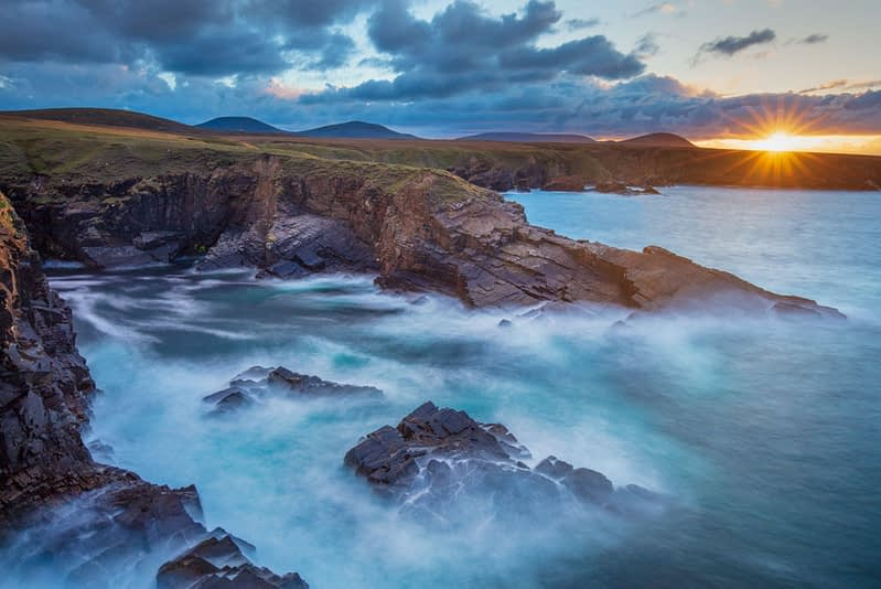 Coastal sunset along the Atlantic Drive, Achill Island, County Mayo, Ireland.
