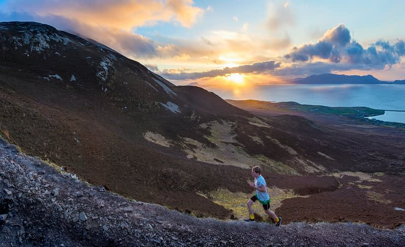 Triathlete Con Doherty racing the sunset on Croagh Patrick, County Mayo, Ireland.