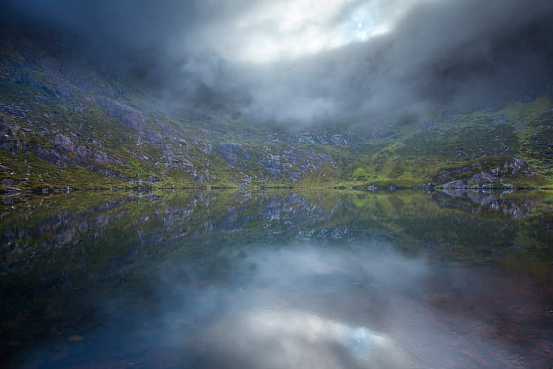Misty reflections in Loch Doon (Loch an Pheidleara), Connor Pass, Dingle Peninsula, County Kerry, Ireland.