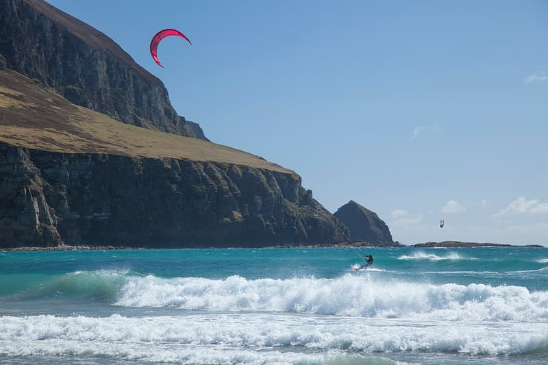 Sophie Mathews kitesurfing beneath Minaun Cliffs, Achill Island, County Mayo, Ireland.