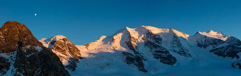 Moonrise over Piz Trovat and Piz Palu, Berniner Alps, Graubunden, Switzerland.