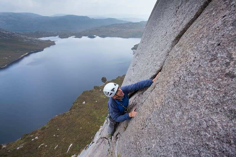 Geoff Thomas near the crux of Classical Revival (HVS 4c,5a,4c), Lough Belshade, Bluestack Mountains, County Donegal, Ireland.