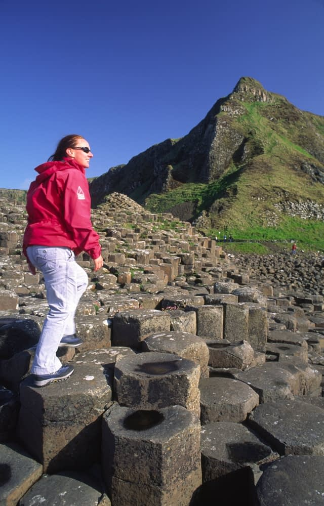 Person on the basalt columns of the Giant's Causeway, Co Antrim, Northern Ireland.