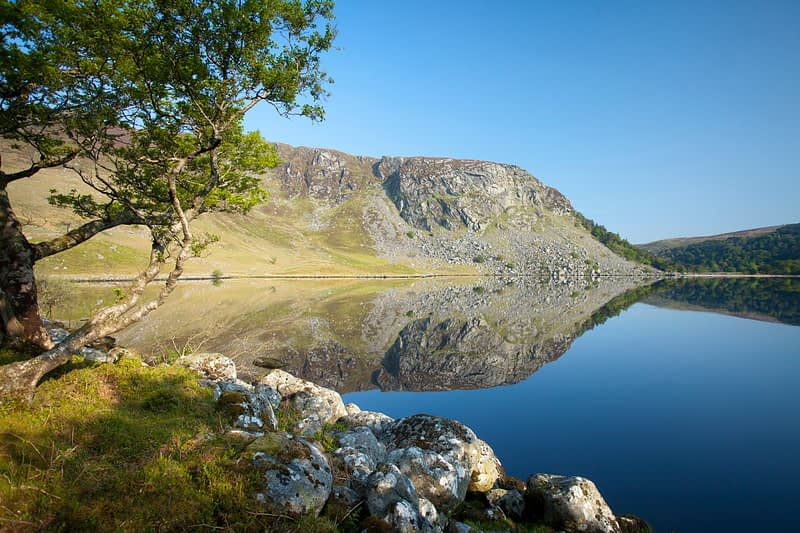 The cliffs of Luggala reflected in Lough Tay, Wicklow Mountains, County Wicklow, Ireland.