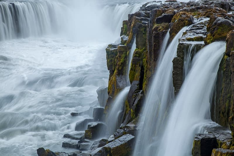 The cliffs and cascades of Godafoss waterfall, Nordhurland Eystra, Iceland.