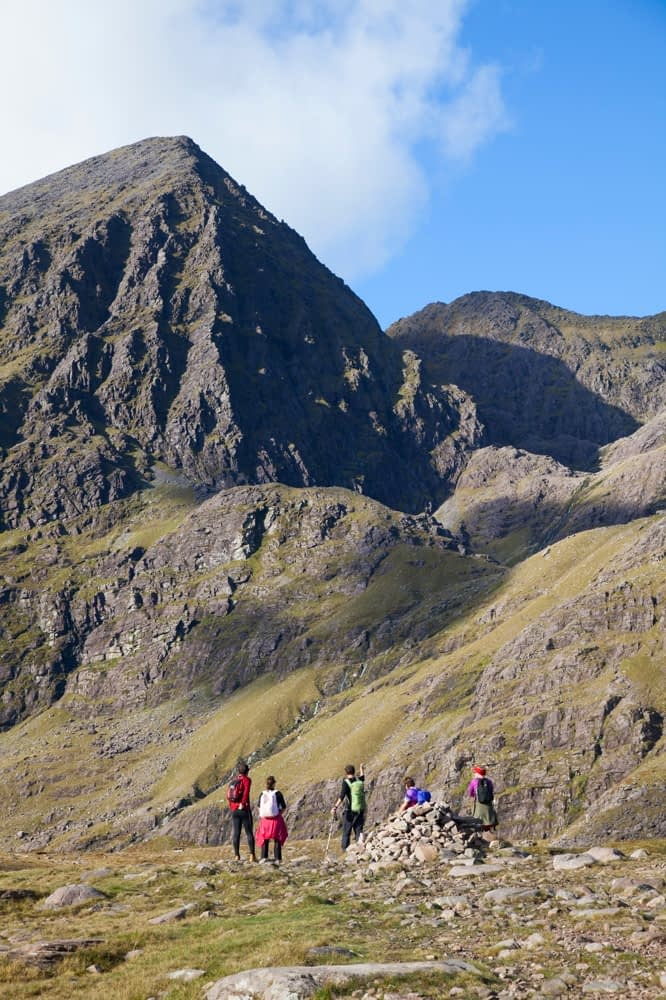 Walkers in Hag's Glen beneath Carrauntoohil, MacGillycuddy's Reeks, County Kerry, Ireland.