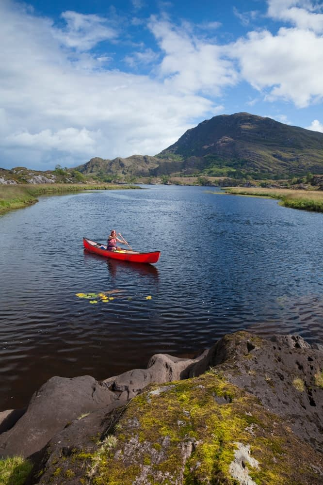 Canoeing on The Long Range, Killarney Lakes, Killarney National Park, County Kerry, Ireland.