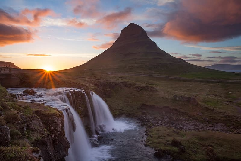 Sunset over Kirkjufell mountain and waterfall, Grundarfjordur, Snaefellsnes Peninsula, Vesturland, Iceland.
