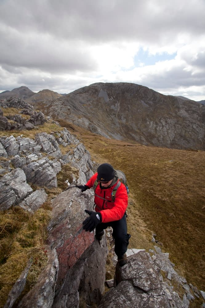 Scrambling on Benbaun, Twelve Bens Mountains, Connemara, Co Galway Ireland.