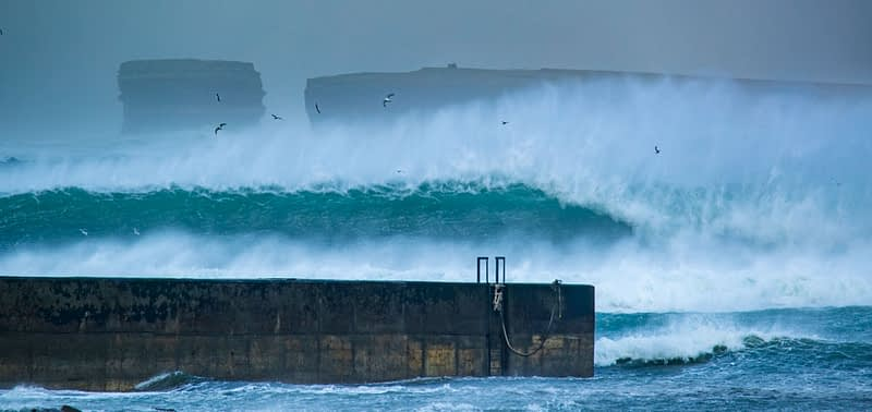 Storm waves loom over Ballycastle pier, beneath Downpatrick Head, County Mayo, Ireland.