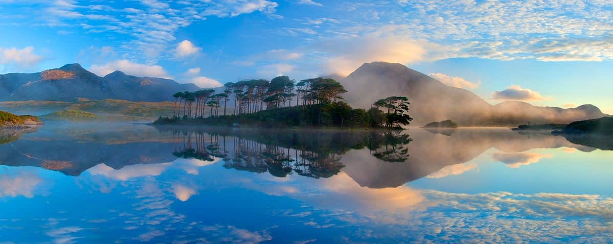 Misty morning reflection of the Twelve Bens in Derryclare Lough, Connemara, Co Galway, Ireland.