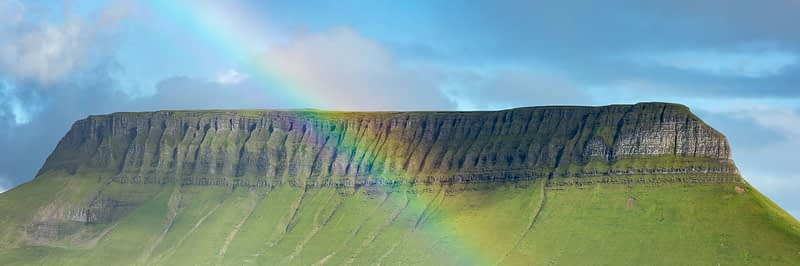 Rainbow beneath Benbulbin mountain, County Sligo, Ireland.