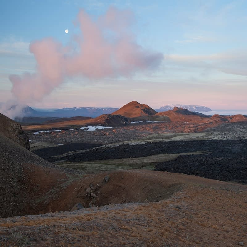 Dawn moon over the smouldering lava field at Leirhnjukur, Krafla volcano, Myvatn, Nordhurland Eystra, Iceland.