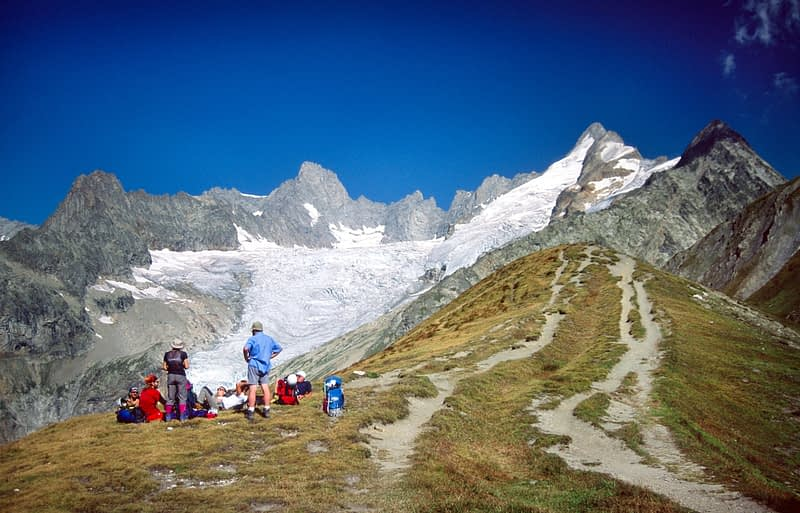 Walkers on the Grand Col Ferret, Tour of Mont Blanc, Italian Alps, Italy.