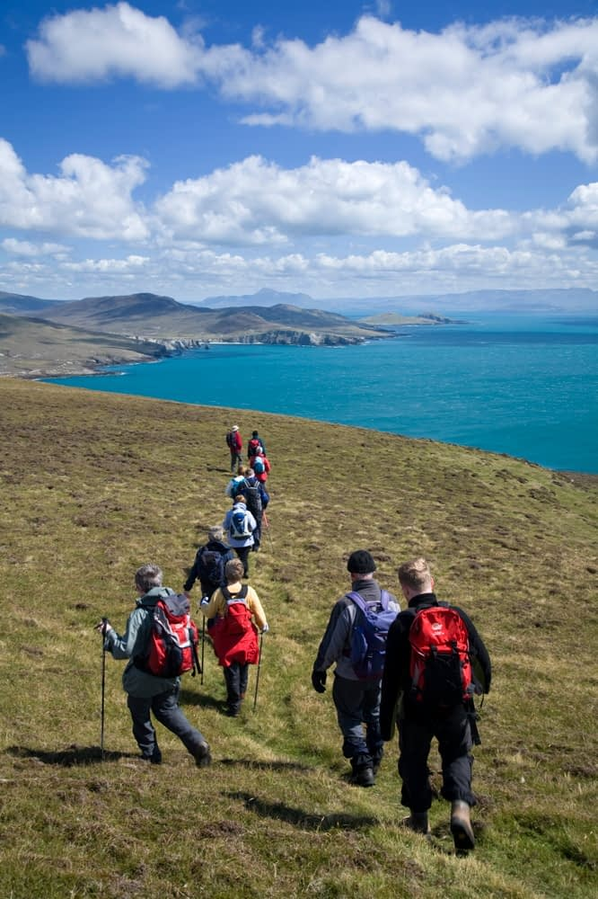 Walkers descending from the Menawn Cliffs, Achill Island, Co Mayo, Ireland.