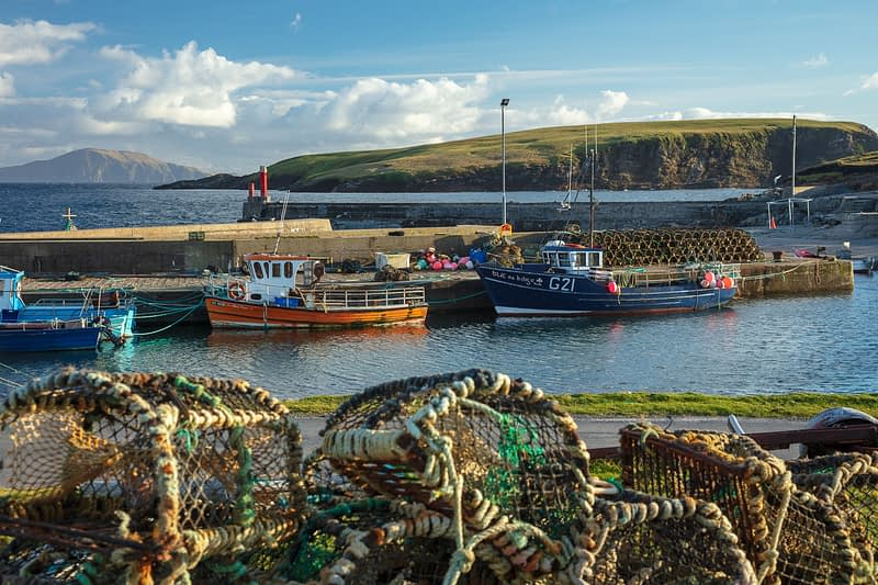 Fishing Boats and lobster pots at Purteen Harbour, Achill Island, County Mayo, Ireland.