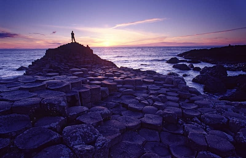 Sunset figure at the Giant's Causeway, Co Antrim, Northern Ireland.