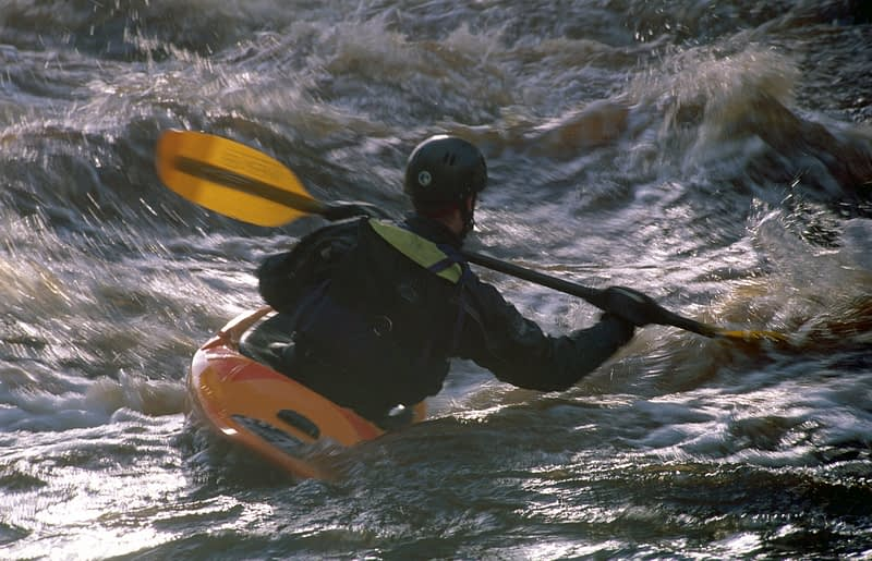 Kayaker on the River Roe, Limavady, County Derry, Northern Ireland.