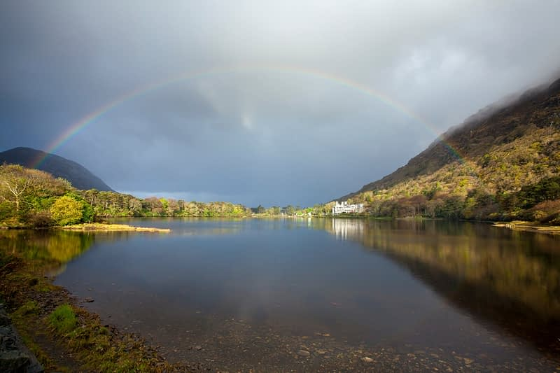 Rainbow over Kylemore Lough and  Kylemore Abbey, Connemara, Co Galway, Ireland.