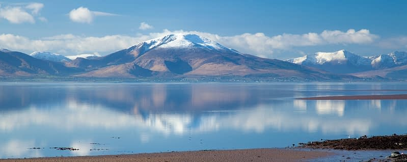 Baurtregaum mountain reflected in Tralee Bay, Dingle Peninsula, County Kerry, Ireland.