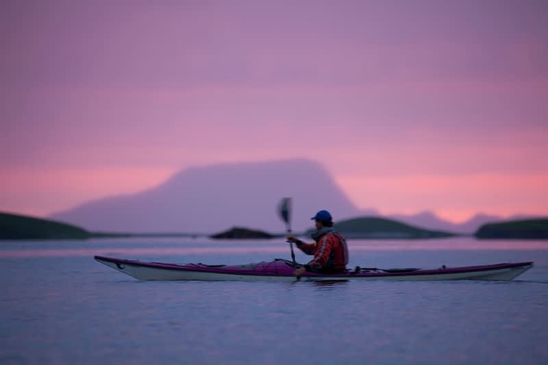 Sea kayaker at sunset in Clew Bay, Co Mayo Ireland.