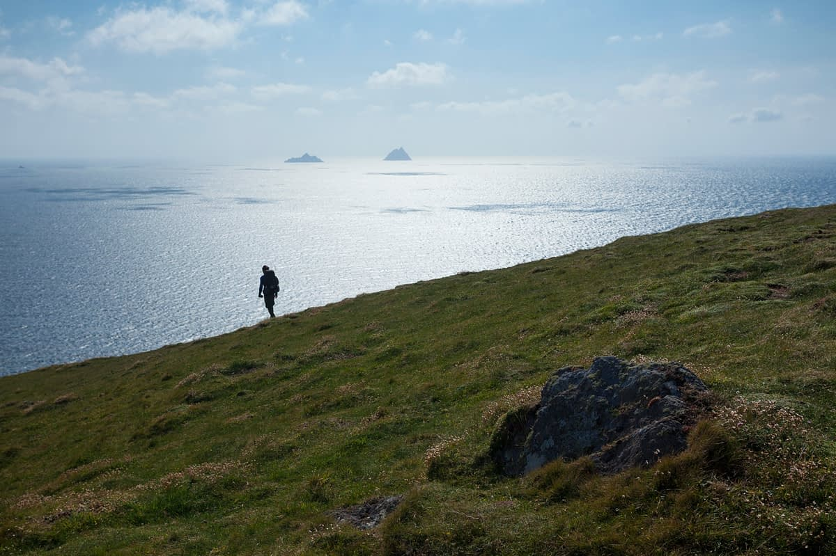 Walker silhouetted on Bray Head, Valentia Island, County Kerry, Ireland.