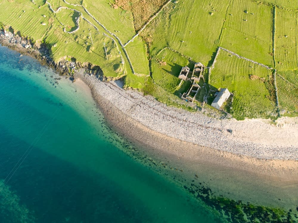 Aerial view of deserted cottages on Achillbeg Island, County Mayo, Ireland.