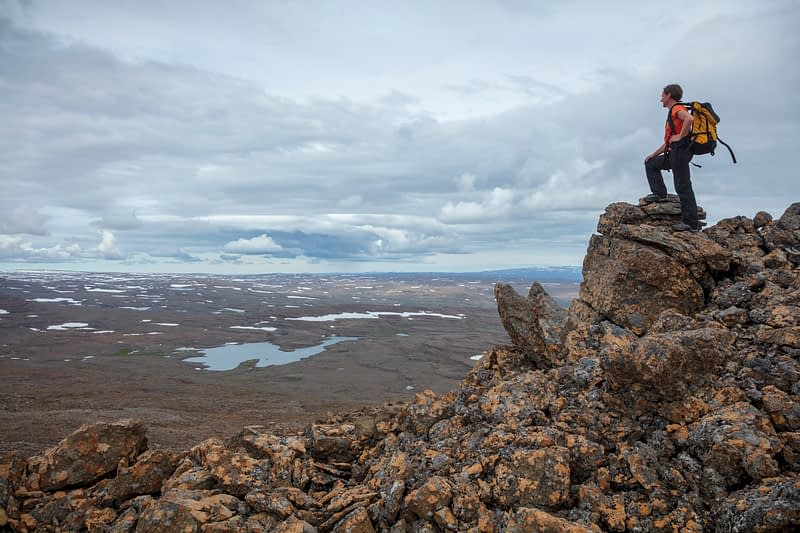 Hiker looking across the Glama plateau from the 752m summit of Lomfell mountain. Westfjords, Iceland.